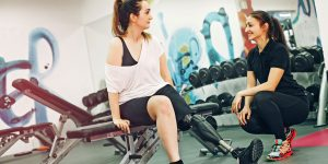 Disability Support worker with a girl in the gym